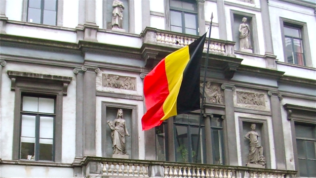 Belgian flag flying in Brussels. Photo: Andrew Cornwell. All rights reserved.